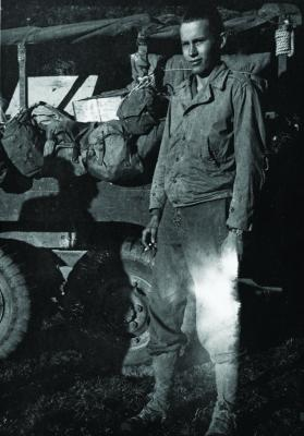 Richard Wilbur circa 1944, standing near the 6 X 6 truck that transported gear for the 36th Texans Division during World War II.