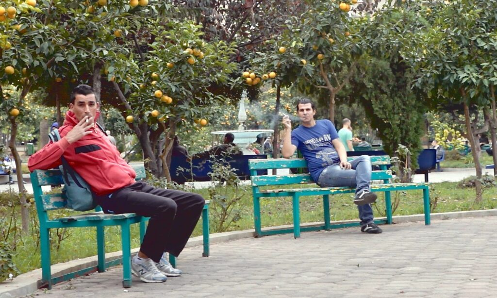Image of men smoking in the park