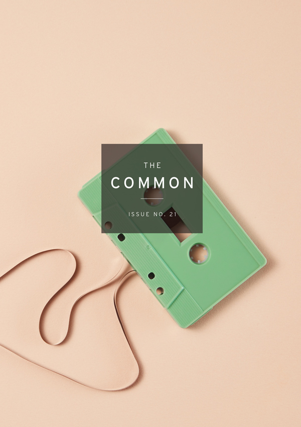 The Common Issue 21 cover with a green cassette tape on a creamy beige background