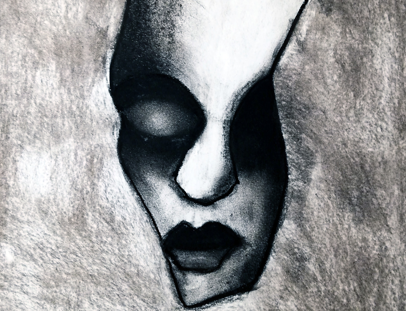 Face sketched in B&W